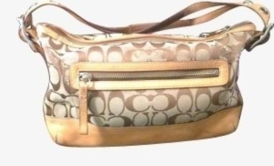 Preload https://item4.tradesy.com/images/coach-small-fabric-handbag-brown-and-golden-leather-signature-canvas-camel-trim-hobo-bag-26253-0-0.jpg?width=440&height=440