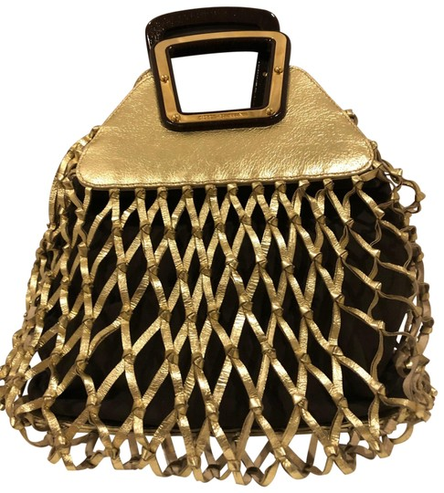 Preload https://img-static.tradesy.com/item/26262863/dolce-and-gabbana-woven-metallic-gold-leather-tote-0-1-540-540.jpg