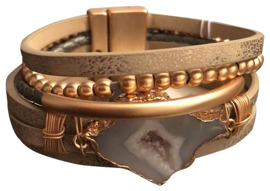 Preload https://img-static.tradesy.com/item/26284060/saachi-taupe-cuff-leather-magnet-closure-bracelet-0-2-540-540.jpg