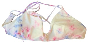 RVCA New with tags RVCA cream, pink and purple tiedye bikini top / swim top size large. This listing is for the top Only. If you want to purchase the top and bottom as a full bikini set please look for the other listing that specifies full bikini set. Top alone after taxes was $55