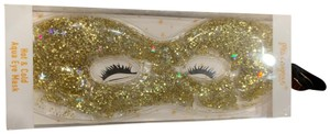 Miss Gorgeous New in original box gold glitter hot & cold aqua eye mask. Helps soothe headaches and relaxation. Easy to use, adjustable fit; microwaveable and freezeable; reduces eye puffiness and pampers tired eyes!