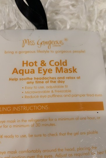 Miss Gorgeous New in original box gold glitter hot & cold aqua eye mask. Helps soothe headaches and relaxation. Easy to use, adjustable fit; microwaveable and freezeable; reduces eye puffiness and pampers tired eyes! Image 2