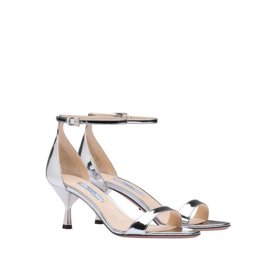 Preload https://img-static.tradesy.com/item/26300822/prada-silver-65-metallic-halo-strap-leather-sandals-size-us-75-regular-m-b-0-0-540-540.jpg