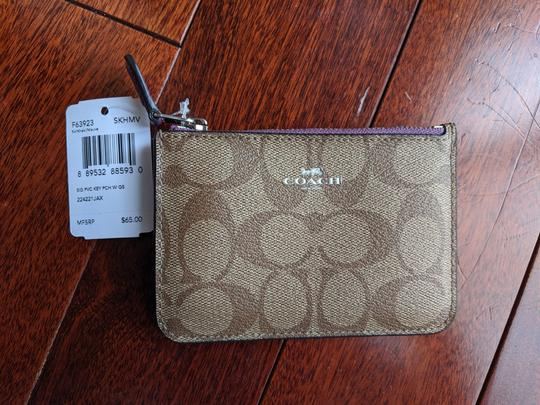 Preload https://img-static.tradesy.com/item/26304258/coach-tan-keychain-wallet-0-1-540-540.jpg
