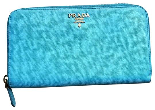 Preload https://img-static.tradesy.com/item/26305243/prada-blueaqua-saffiano-leather-zip-around-wallet-0-4-540-540.jpg