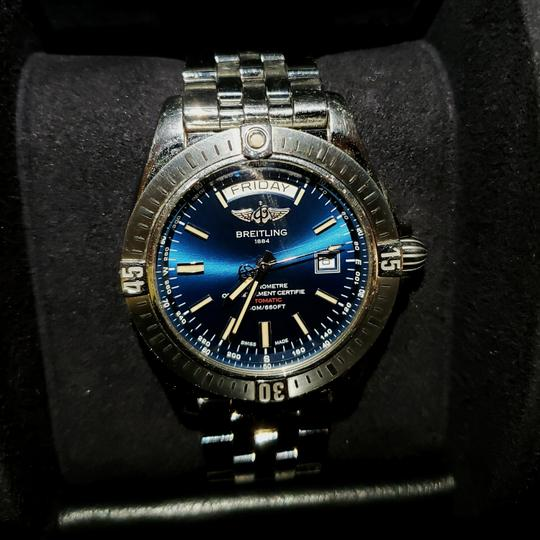 Preload https://item4.tradesy.com/images/breitling-silver-and-blue-galactic-44-watch-26330958-0-1.jpg?width=440&height=440