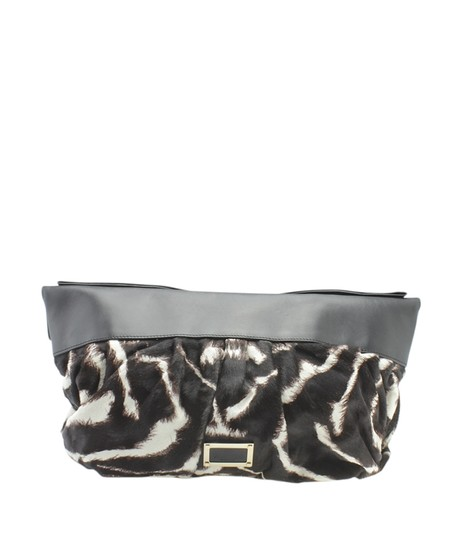 Preload https://img-static.tradesy.com/item/26331080/valentino-hair-and-brown-leather-178839-whitexbrown-pony-hairxleather-clutch-0-0-540-540.jpg