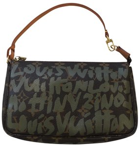 Louis Vuitton Wristlet in brown