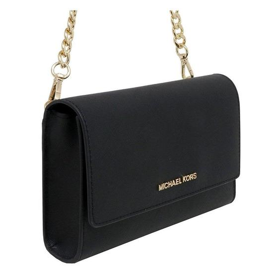 Preload https://item4.tradesy.com/images/michael-kors-crossbody-women-s-jet-set-travel-black-saffiano-leather-clutch-26334248-0-0.jpg?width=440&height=440
