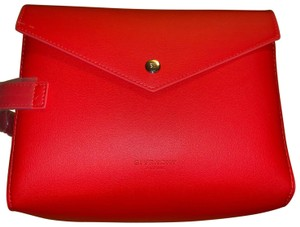 Givenchy Givenchy red magnetic closure cosmetic bag.