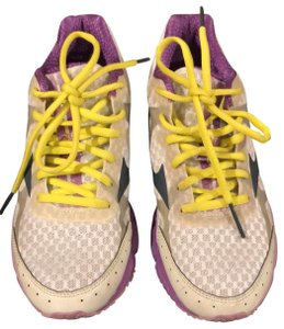 Mizuno white with purple trim and yellow shoelaces Athletic