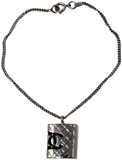 Preload https://img-static.tradesy.com/item/26346471/chanel-silver-silver-tone-metal-quilted-cc-quilted-charm-bracelet-0-3-540-540.jpg