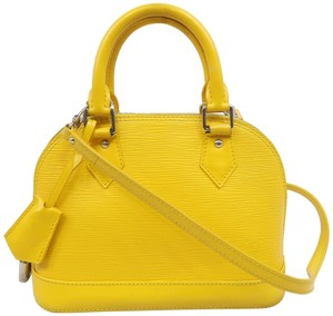 Louis Vuitton Lv Alma Epi Satchel in Yellow
