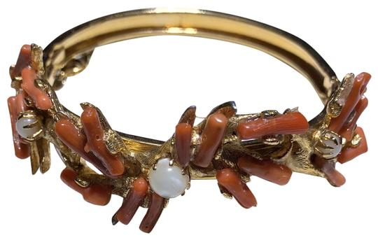 Preload https://img-static.tradesy.com/item/26354473/gold-hinged-bangle-with-coral-pieces-bracelet-0-2-540-540.jpg