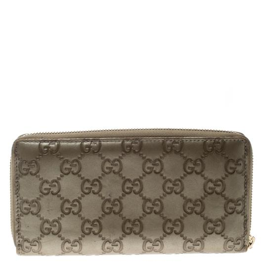 Gucci Gucci Gold Guccissima Leather Zip Around Wallet Image 1