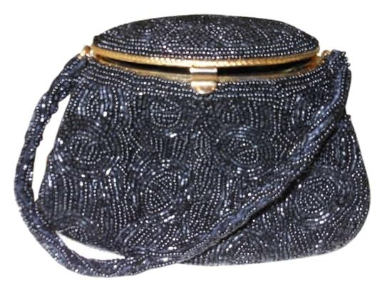 Preload https://item4.tradesy.com/images/evening-black-with-gold-trim-beads-wristlet-263808-0-0.jpg?width=440&height=440