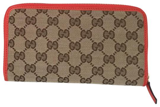 Preload https://img-static.tradesy.com/item/26386825/gucci-orange-canvas-leather-with-zip-wallet-0-2-540-540.jpg