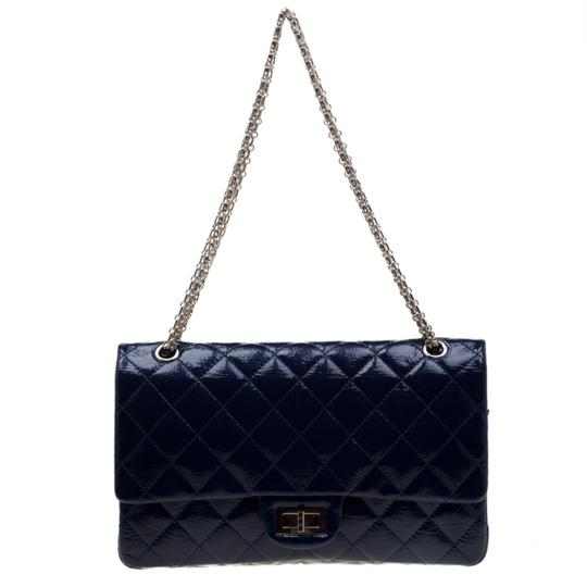 Preload https://img-static.tradesy.com/item/26389399/chanel-classic-flap-255-reissue-quilted-227-black-patent-leather-shoulder-bag-0-0-540-540.jpg