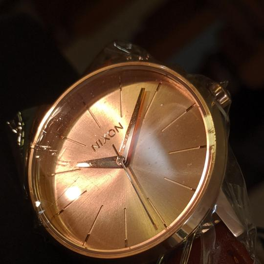 Preload https://item4.tradesy.com/images/nixon-kensington-rose-gold-2-straps-gift-set-black-and-brown-included-watch-26389678-0-0.jpg?width=440&height=440