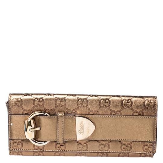 Preload https://img-static.tradesy.com/item/26389923/gucci-gold-guccissima-leather-buckle-continental-wallet-0-0-540-540.jpg