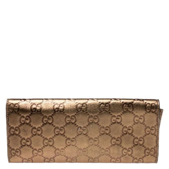 Gucci Gucci Gold Guccissima Leather Buckle Continental Wallet Image 1