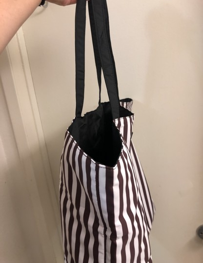 Henri Bendel Tote in Colors: Black on one side and other side has brown/white stripes with beautiful IZAK girl print Image 1