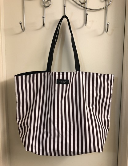 Henri Bendel Tote in Colors: Black on one side and other side has brown/white stripes with beautiful IZAK girl print Image 3