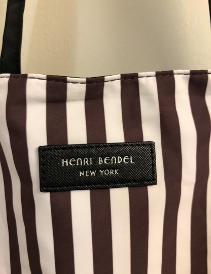 Henri Bendel Tote in Colors: Black on one side and other side has brown/white stripes with beautiful IZAK girl print Image 5