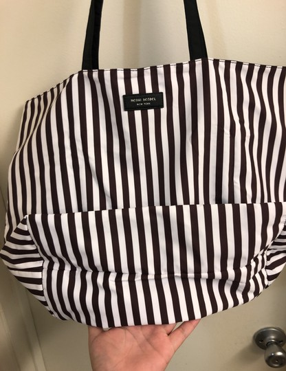 Henri Bendel Tote in Colors: Black on one side and other side has brown/white stripes with beautiful IZAK girl print Image 6