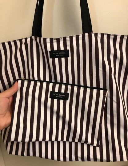 Henri Bendel Tote in Colors: Black on one side and other side has brown/white stripes with beautiful IZAK girl print Image 8