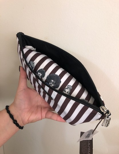 Henri Bendel Tote in Colors: Black on one side and other side has brown/white stripes with beautiful IZAK girl print Image 9