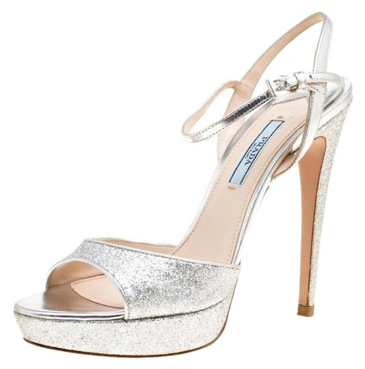 Preload https://img-static.tradesy.com/item/26426790/prada-silver-glitter-and-leather-ankle-strap-platform-sandals-size-eu-37-approx-us-7-regular-m-b-0-1-540-540.jpg