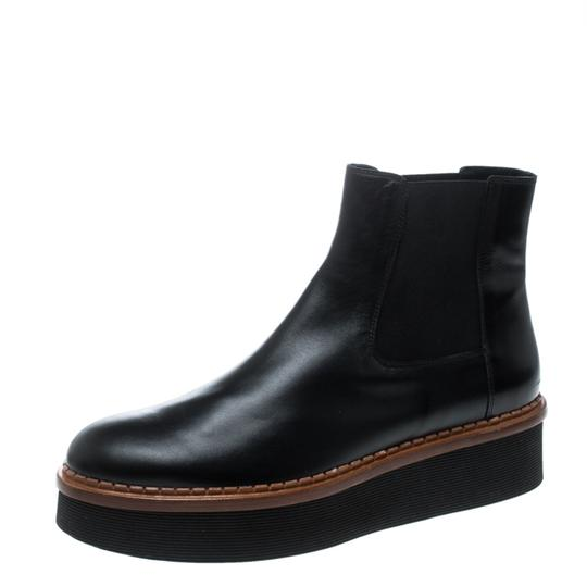 Preload https://img-static.tradesy.com/item/26427107/tod-s-black-leather-platform-ankle-bootsbooties-size-eu-41-approx-us-11-regular-m-b-0-0-540-540.jpg
