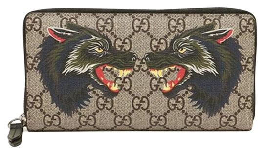 Preload https://img-static.tradesy.com/item/26437263/gucci-beigeebony-clutch-new-beigeebony-wolf-print-gg-supreme-canvas-zip-card-case-wallet-0-2-540-540.jpg