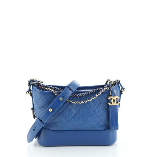Preload https://img-static.tradesy.com/item/26444336/chanel-gabrielle-quilted-aged-small-blue-calfskin-leather-hobo-bag-0-0-540-540.jpg