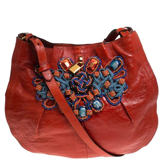 Preload https://img-static.tradesy.com/item/26471499/marc-jacobs-embellished-daisy-orange-patent-leather-hobo-bag-0-0-540-540.jpg