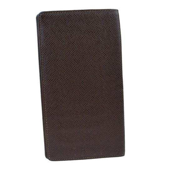 Preload https://img-static.tradesy.com/item/26471724/louis-vuitton-brown-long-bifold-taiga-leather-wallet-0-0-540-540.jpg