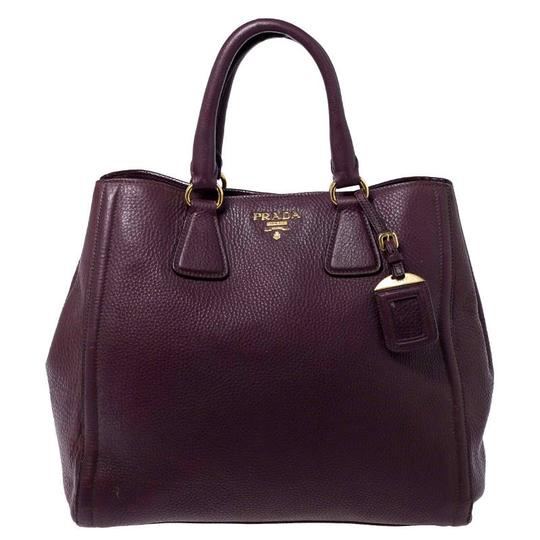 Preload https://img-static.tradesy.com/item/26471849/prada-vitello-daino-burgundy-leather-tote-0-0-540-540.jpg