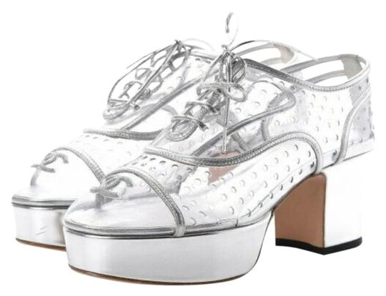 Preload https://img-static.tradesy.com/item/26474285/chanel-pvc-silver-transparent-lace-up-leather-10-platforms-size-eu-405-approx-us-105-regular-m-b-0-6-540-540.jpg