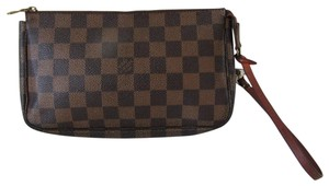 Louis Vuitton Damier Canvas Wristlet in Brown