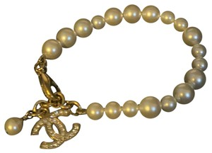 Chanel Chanel pearl gold plated double sided crystal CC bracelet