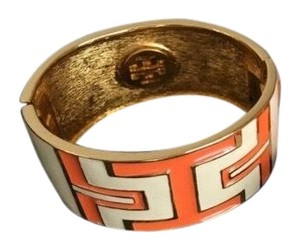 Tory Burch Tory Burch orange/gold bangle bracelet