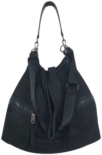 Preload https://img-static.tradesy.com/item/26530258/henri-bendel-shoulder-bag-drawstring-lg-studio-blk-nylonleather-black-nylon-and-leather-tote-0-1-540-540.jpg