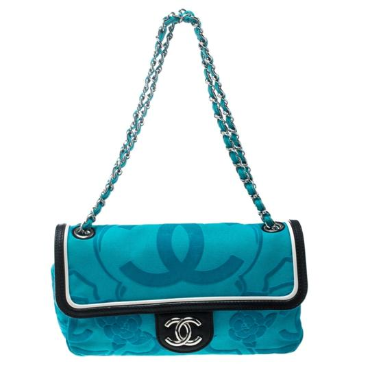 Preload https://img-static.tradesy.com/item/26530318/chanel-turquoise-classic-ultra-rare-limited-edition-flap-blue-canvas-with-leather-trim-shoulder-bag-0-0-540-540.jpg