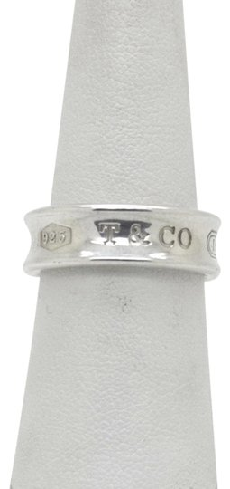 Preload https://img-static.tradesy.com/item/26530546/tiffany-and-co-silver-925-sterling-1837-band-with-pouch-size-75-ring-0-1-540-540.jpg