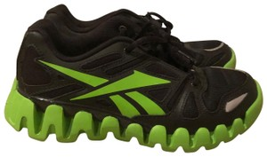 Reebok Black leather and green Athletic