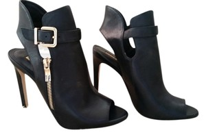 BCBG Sexy Buckle black Boots