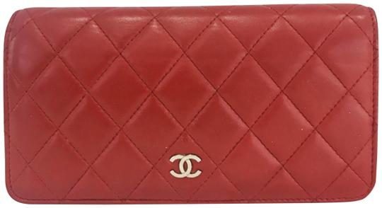 Preload https://img-static.tradesy.com/item/26593699/chanel-red-lamb-leather-quilted-yen-wallet-0-2-540-540.jpg