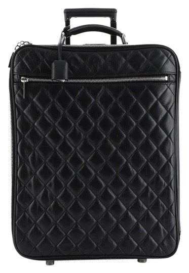 Preload https://img-static.tradesy.com/item/26593703/chanel-paris-new-york-rolling-trolley-quilted-aged-calfskin-black-leather-weekendtravel-bag-0-1-540-540.jpg