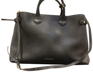 Burberry Satchel in Black with house check on side panels.